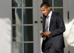 US President Barack Obama uses his Black